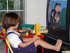Child closely watching TV